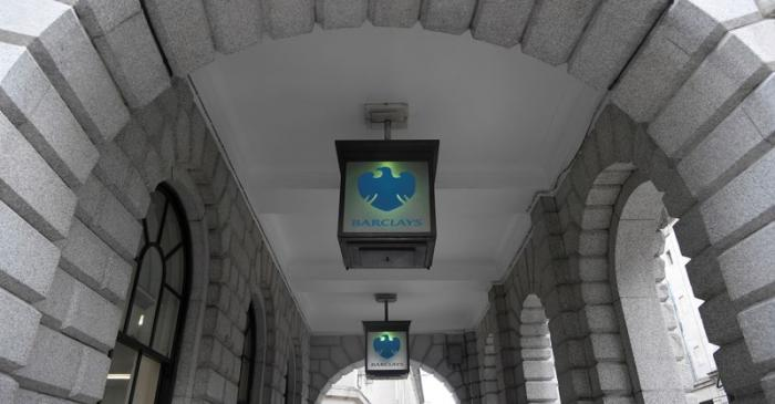 FILE PHOTO: The logo of Barclays bank is seen on glass lamps outside of a branch of the bank in