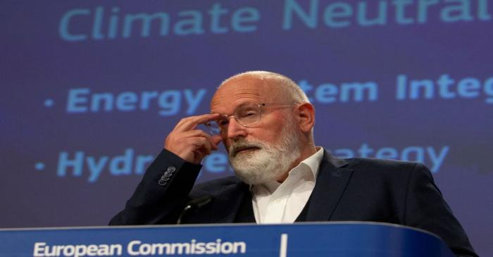FILE PHOTO: European Commissioner for European Green Deal Frans Timmermans speaks during a news