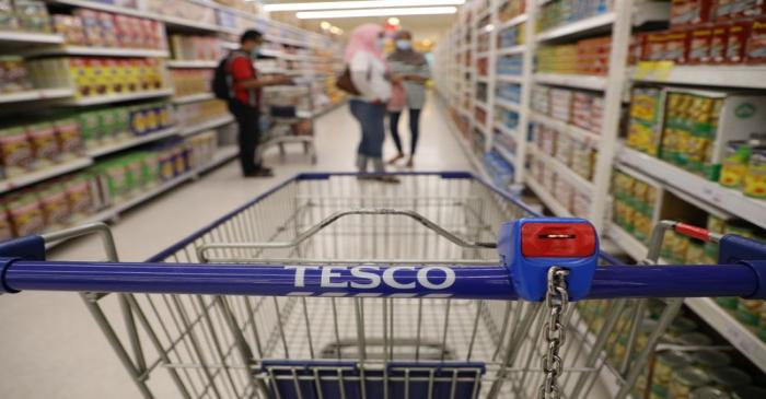 FILE PHOTO: A shopping cart is pictured in a Tesco supermarket, amid the coronavirus disease