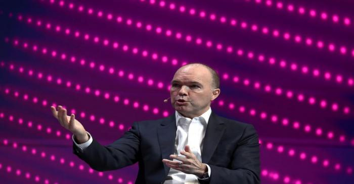 FILE PHOTO: Nick Read, CEO of Vodafone, gestures as he speaks during the Mobile World Congress