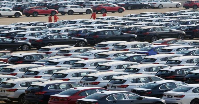Newly manufactured cars are seen at a port in Dalian