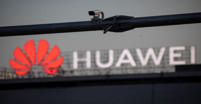 A surveillance camera is seen in front of a Huawei logo, in Belgrade