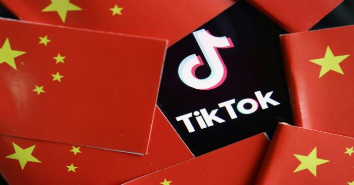 FILE PHOTO: Illustration picture of Tiktok with Chinese flags
