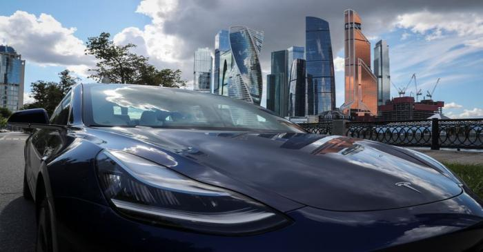 A Tesla Model 3 electric vehicle is shown in Moscow