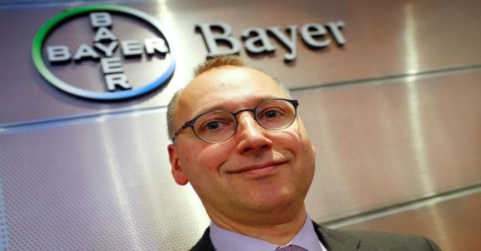FILE PHOTO: Bayer CEO Baumann is posing in front of the drugmaker's logo following the annual