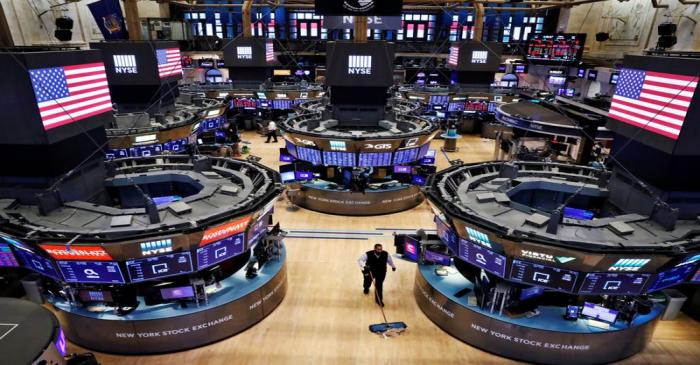 FILE PHOTO: A worker cleans the floor of the New York Stock Exchange (NYSE)