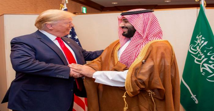 FILE PHOTO: Saudi Arabia's Crown Prince Mohammed bin Salman shakes hands with U.S. President