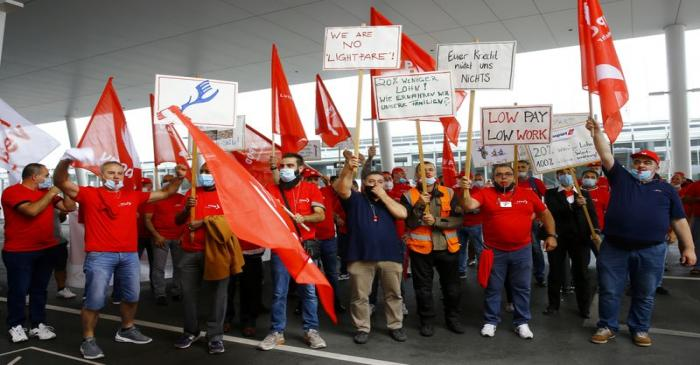 FILE PHOTO: Members of the VPOD public services workers union display placards during a