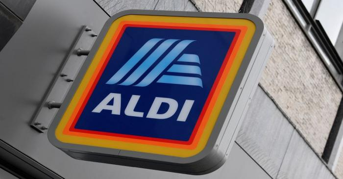 Signage is seen at a branch of Aldi Local, London