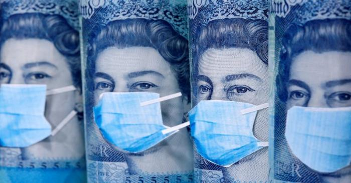 FILE PHOTO: Queen Elizabeth II is seen with printed medical masks on the Pound banknotes in