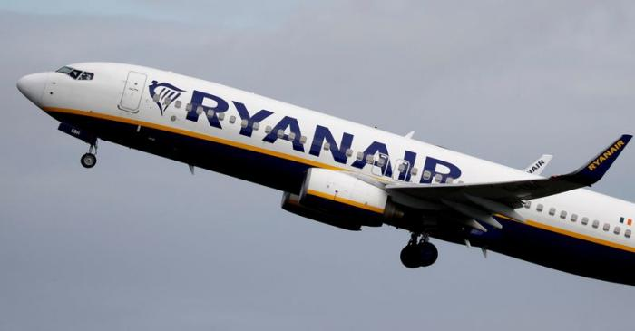 FILE PHOTO: A Ryanair plane takes off from Manchester Airport as the spread of the coronavirus