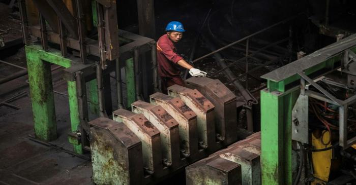 FILE PHOTO: Worker is seen at a hot rolling production line at the Chongqing Iron and Steel
