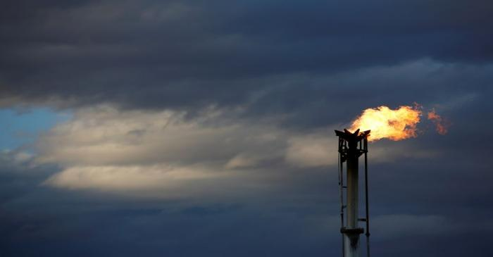 FILE PHOTO: A flare burns off excess gas from a gas plant in the Permian Basin in Loving County