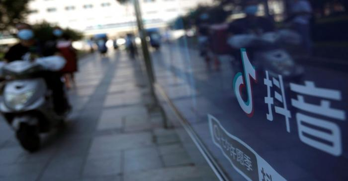 A logo of TikTok (Douyin) is seen on an advertisement at a bus stop in Beijing