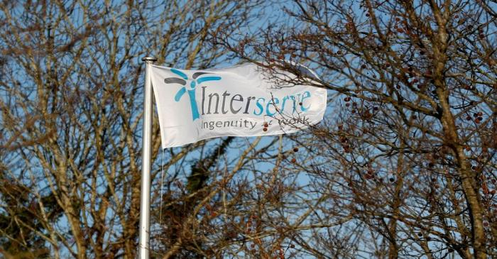 FILE PHOTO: The Interserve logo is seen on a flag at Interserve offices in Twyford