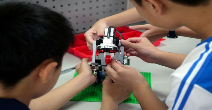 FILE PHOTO: Elementary school students build a motion sensor controlled disinfectant dispenser