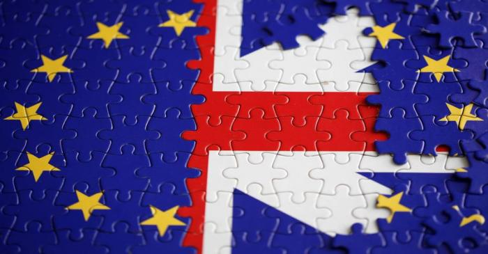 Puzzle with printed EU and UK flags