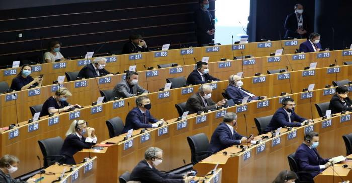FILE PHOTO: Members of the European Parliament wait  for the start of a plenary session in