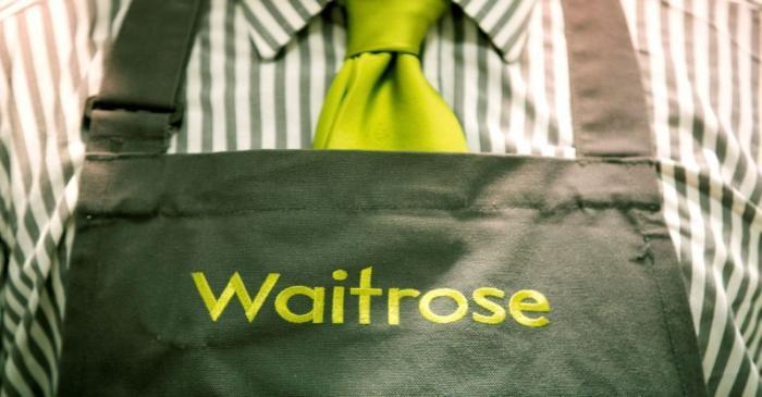 FILE PHOTO: A Waitrose staff member's uniform is seen in London