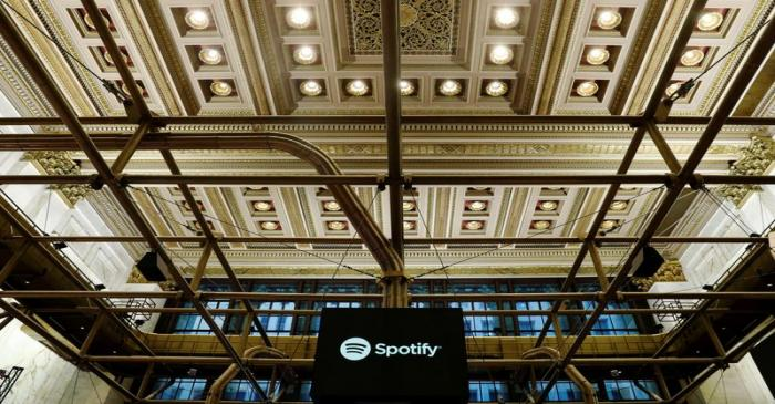 FILE PHOTO: The Spotify logo is displayed as the stock waits to begin selling as a direct