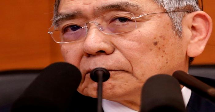 FILE PHOTO: Bank of Japan Governor Haruhiko Kuroda attends a news conference in Tokyo