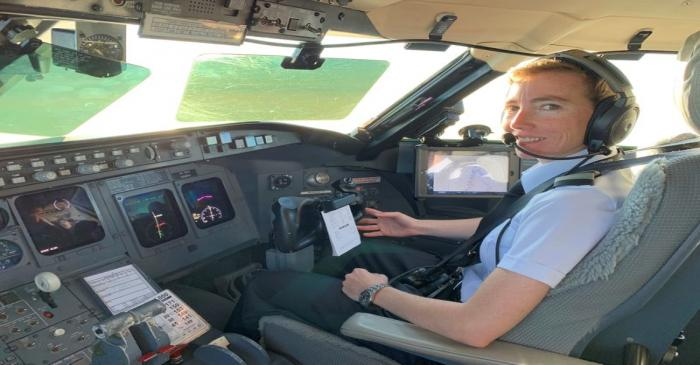 PSA pilot Megyn Thompson in the cockpit of a Bombardier CRJ jet near Washington