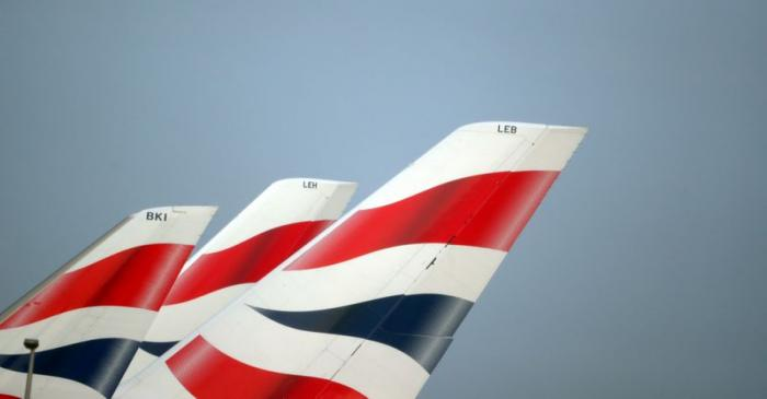 FILE PHOTO: FILE PHOTO: British Airways logos are seen on tail fins at Heathrow Airport in west