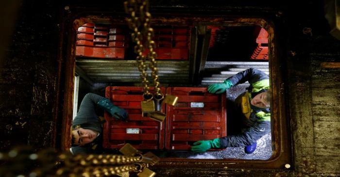 FILE PHOTO: Fishermen of French trawler