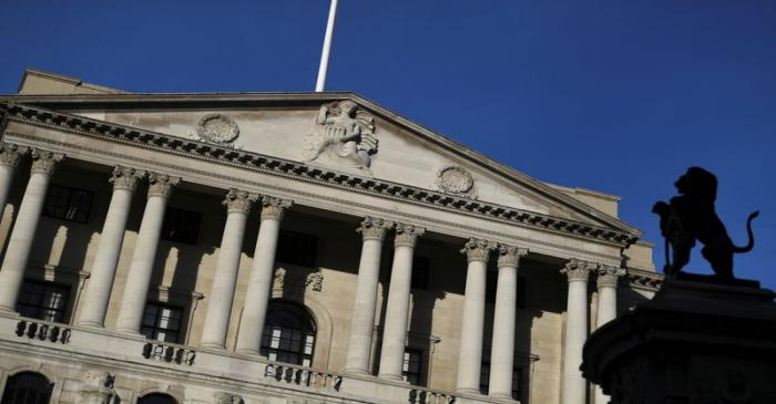 FILE PHOTO: A statue is silhouetted against the Bank of England in the City of London