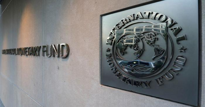 IMF logo is seen outside the headquarters building in Washington