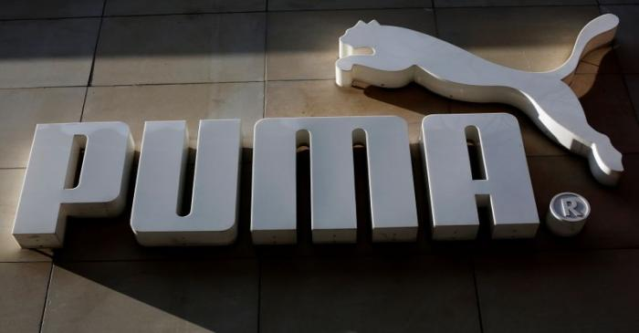 The logo of German sports goods firm Puma is seen at the entrance of one of its stores in