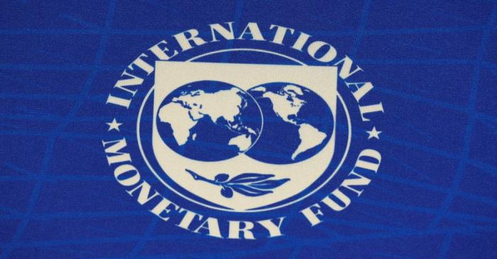 FILE PHOTO: The logo of the International Monetary Fund (IMF), is seen during a news conference