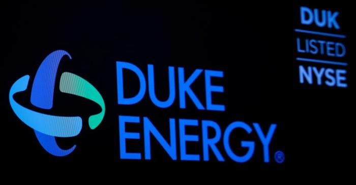 FILE PHOTO: The company logo and ticker for Duke Energy Corp. is displayed on a screen on the