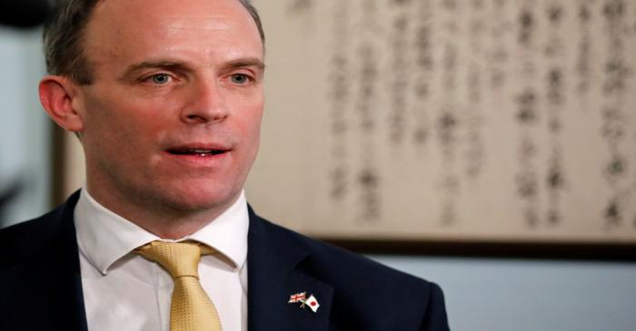 FILE PHOTO: British Foreign Secretary Dominic Raab talks during an interview with Reuters at