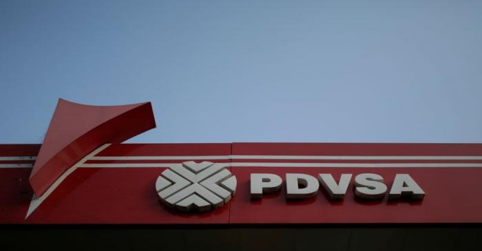 FILE PHOTO: The corporate logo of the state oil company PDVSA is seen at a gas station in