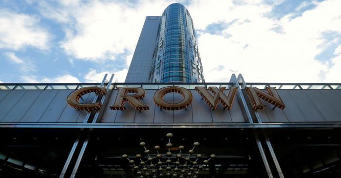FILE PHOTO: The logo of Australian casino giant Crown Resorts Ltd adorns a hotel and casino