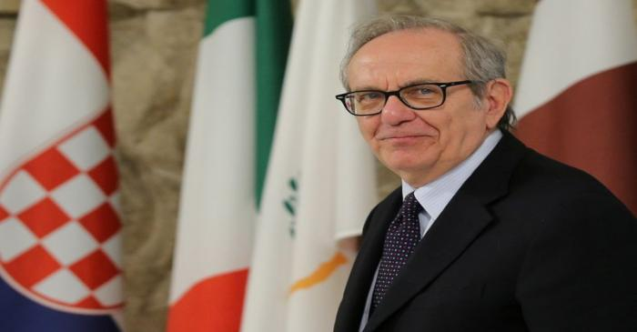 FILE PHOTO: Italian Economy Minister Carlo Padoan arrives for the Informal meeting of economic