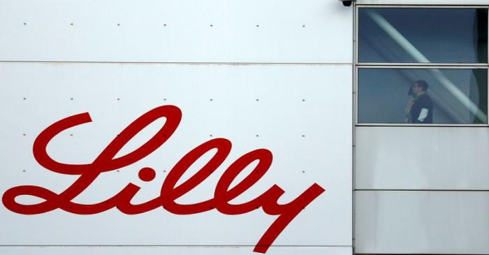 FILE PHOTO: The logo of Lilly is seen on a wall of the Lilly France company unit, part of the