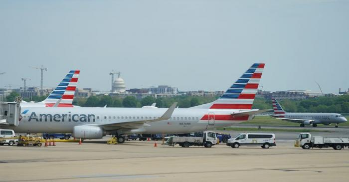 FILE PHOTO: Boeing 737 jet sits at a gate at Washington's Reagan National airport with U.S.