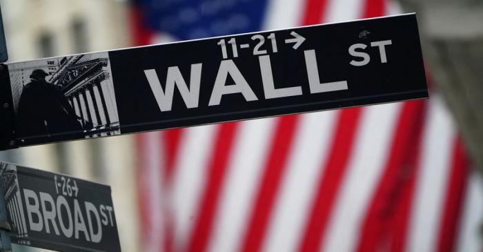 A Wall Street sign is pictured outside the New York Stock Exchange, in New York City
