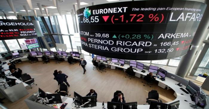 FILE PHOTO: Stock market operators work at the Euronext headquarters at La Defense business and