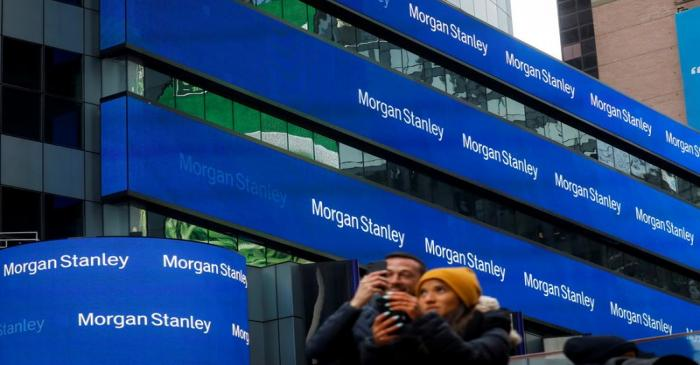 FILE PHOTO: People take photos by the Morgan Stanley building in Times Square in New York