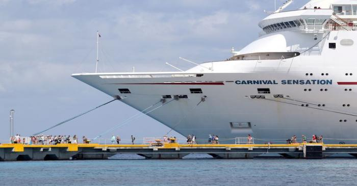 FILE PHOTO: Passengers of the Carnival Sensation, operated by Carnival Cruise Line, are seen