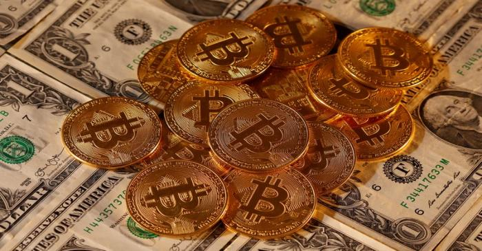 FILE PHOTO: Representations of virtual currency Bitcoin and U.S. dollar banknotes are seen in