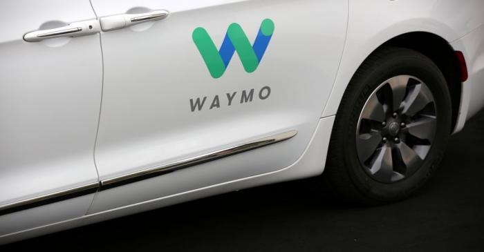 FILE PHOTO: A Waymo Chrysler Pacifica Hybrid self-driving vehicle is parked and displayed