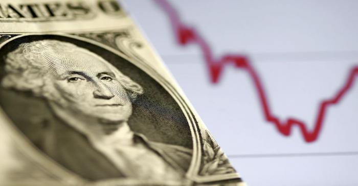 FILE PHOTO: A U.S. dollar note is seen in front of a stock graph in this picture illustration