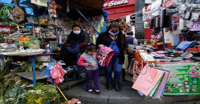 Women are seen at a street market in La Paz