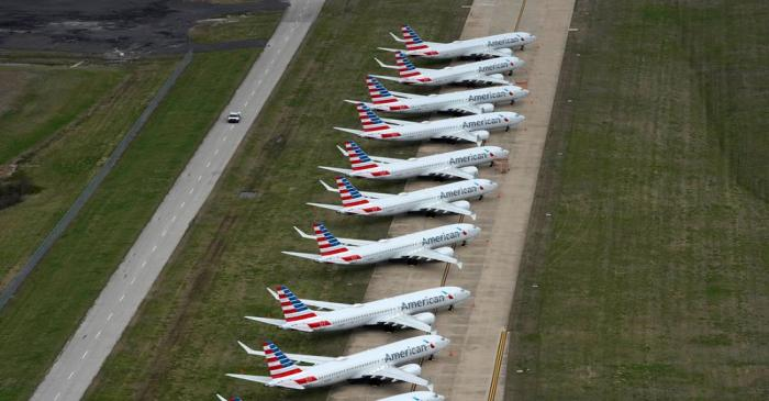 American Airlines 737 max passenger planes are parked on the tarmac at Tulsa International