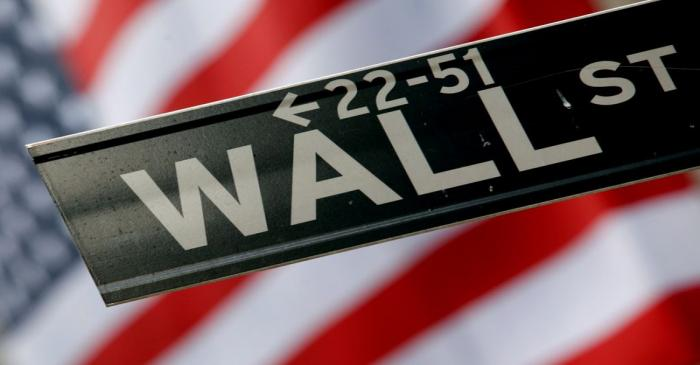 FILE PHOTO: A street sign is seen in front of the New York Stock Exchange on Wall Street in New