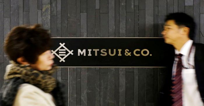 FILE PHOTO: People walk past the logo of Japanese trading company Mitsui & Co in Tokyo